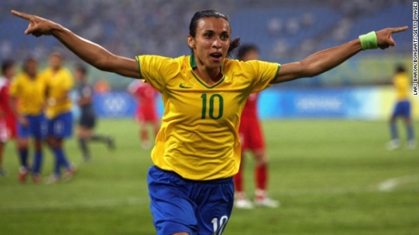 SHENYANG, CHINA - AUGUST 09:  Marta of Brazil celebrates after scoring the second goal during the Women's First Round Group F match between Brazil and North Korea in Shenyang Olympic Stadium on Day 1 of the Beijing 2008 Olympic Games on August 9, 2008 in Shenyang, China.  (Photo by Lars Baron/Bongarts/Getty Images)